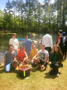 Students with their boat