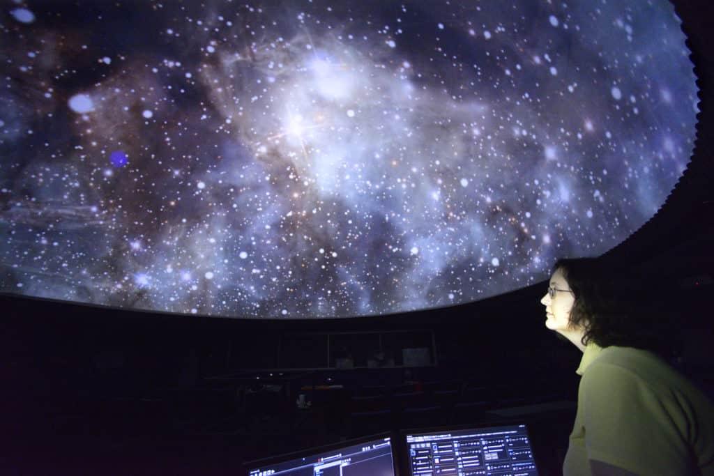 Woman inside Dooley Planetarium