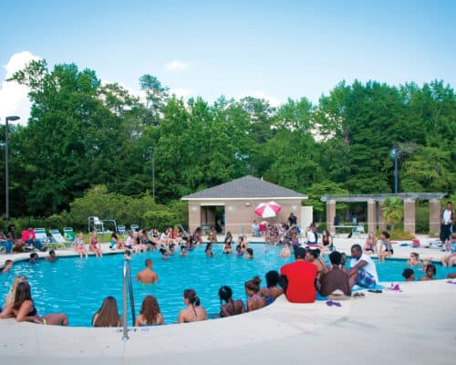 Students gather at the outdoor pool.