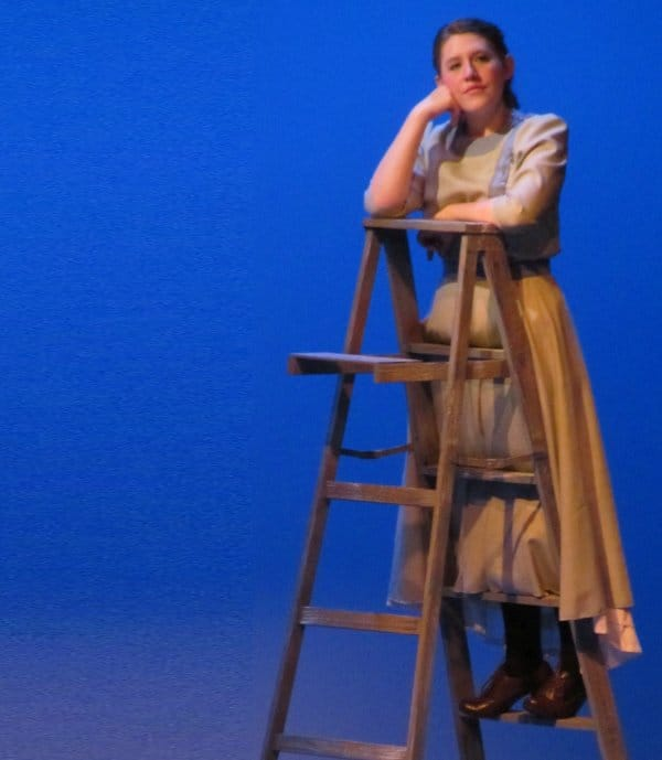 """A students performs in the University Theatre production, """"Our Town."""""""