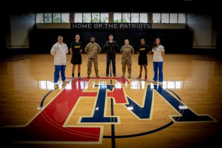 ROTC members pose in the gym.