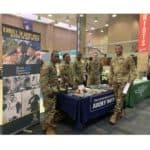 ROTC members ma their table during a recruiting event.
