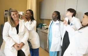 A group of family nurse practitioner students examine the use of a new horoscope.