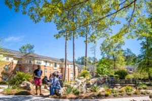 Students gather near the FMU housing area.