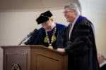 FMU President Dr. Fred Carter and Provost Dr. Peter King smile during commencement.