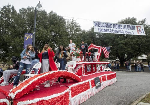 Students jam out on a float during homecoming.