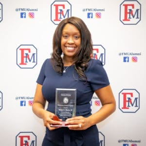 FMU Alumnus Melani Green poses for a photo after winning the 2020 Professional Psychology Award.