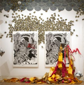 An art installation depicting two paintings surrounded by bees and ribbon.