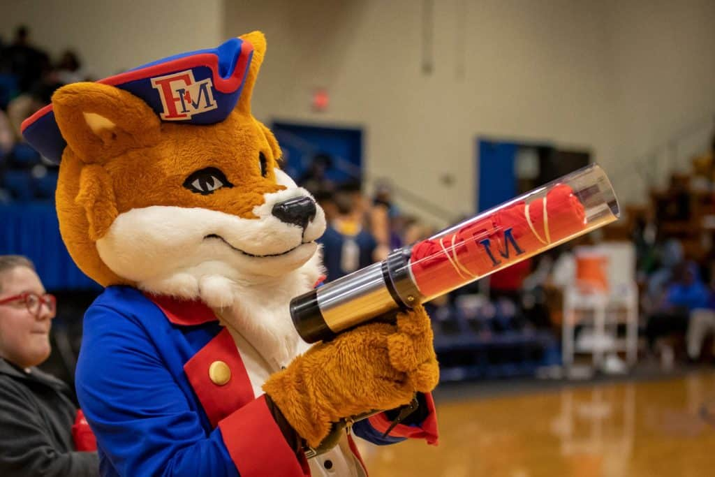 Frank the Fox prepares to shoot a t-shirt cannon at fans