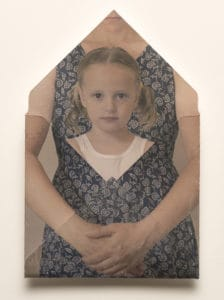 In image transfer piece depicting a woman enveloping her daughter.