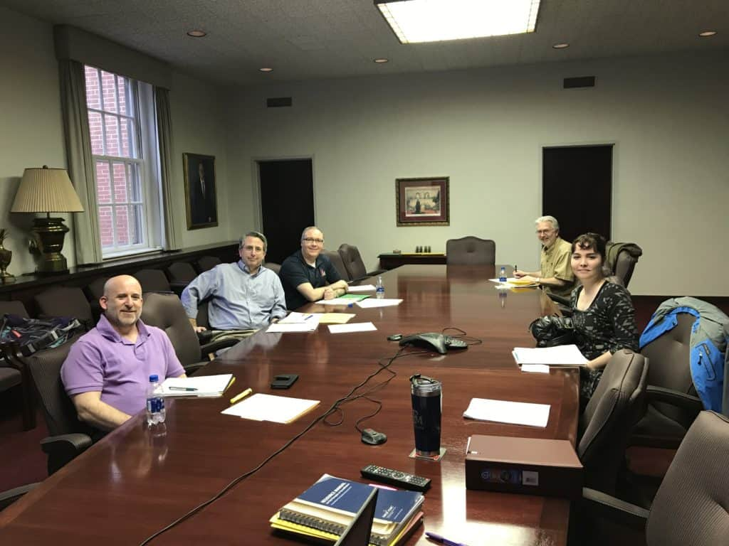A meeting of individuals from the institutional effectiveness department.