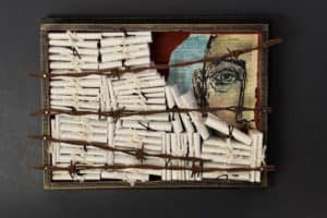 A mixed media piece depicting a box of scrolls.