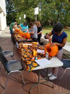 Math majors and math faculty carve pumpkins