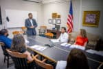 FMU School of Business Dean Dr. Hari Rajagopalan speaks to students during a lecture.